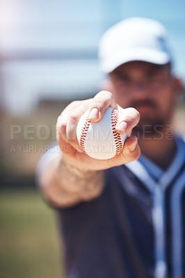 Buy stock photo Shot of a man holding a ball during a baseball match