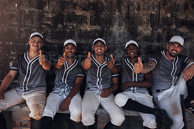 Buy stock photo Shot of a group of young baseball players sitting in the dugout and showing thumbs up
