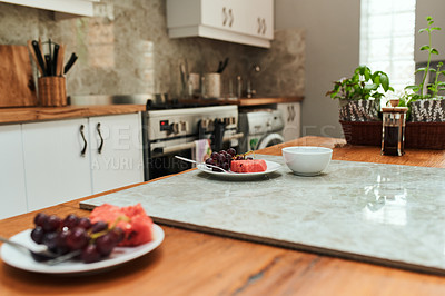 Buy stock photo Shot of two plates on a kitchen counter
