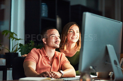 Buy stock photo Cropped shot of two young designers working together at night