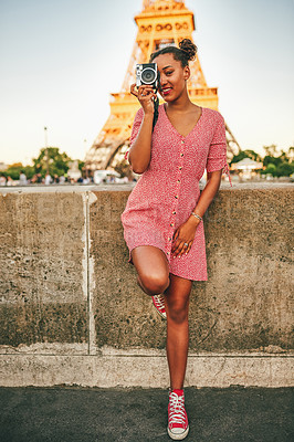 Buy stock photo Full length shot of an attractive young woman exploring and taking pictures in Paris, France