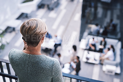 Buy stock photo Rearview shot of a mature businesswoman using a smartphone on the stairs of a modern office