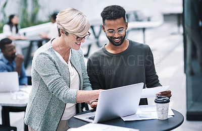 Buy stock photo Shot of a businessman and businesswoman using a laptop during a meeting at a convention centre