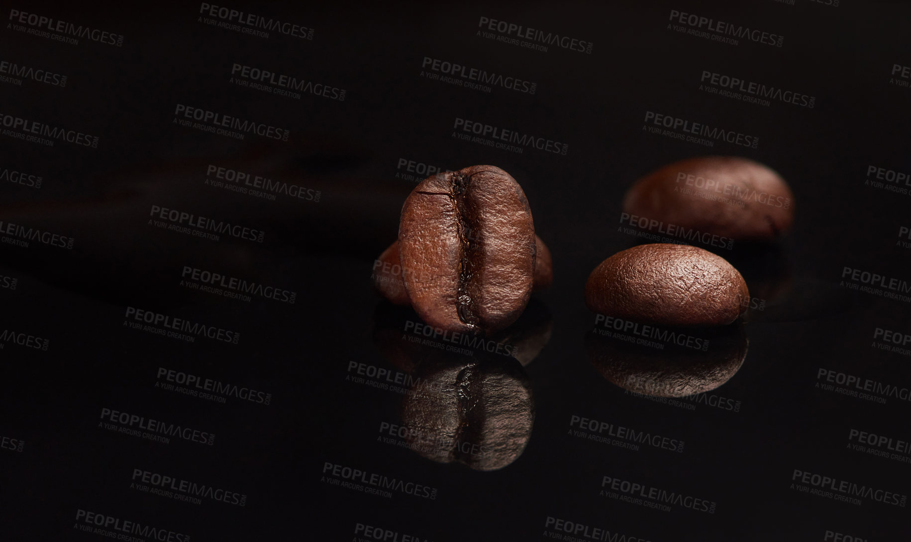 Buy stock photo Studio shot of coffee beans against a black background