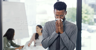 Buy stock photo Shot of a businessman standing aside sneeze while in the boardroom