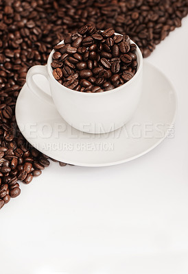 Buy stock photo Closeup shot of a cup filled with coffee beans against a half-and-half background