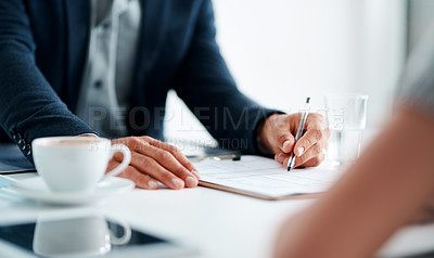 Buy stock photo Closeup shot of an unrecognisable businessman going through paperwork with a woman in an office