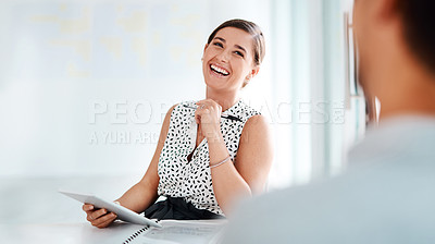 Buy stock photo Shot of a young businesswoman having a discussion with a man in an office