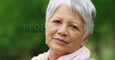 Buy stock photo Portrait of a senior woman spending a day in the park