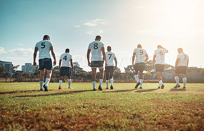 Buy stock photo Rearview shot of a group of young rugby players walking on a field