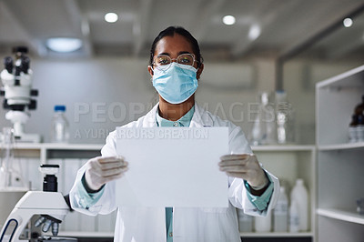 Buy stock photo Cropped portrait of an attractive young female scientist holding up a blank placard while standing in her laboratory