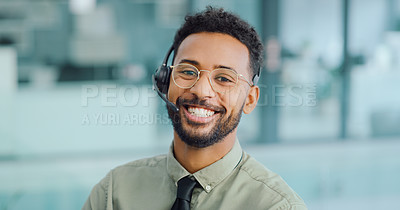 Buy stock photo Portrait of a young man using a headset in a modern office