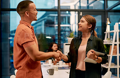 Buy stock photo Shot of two businesspeople shaking hands at the office