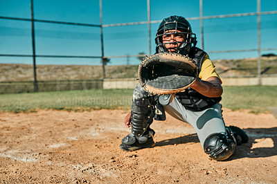 Buy stock photo Shot of the catcher sitting in position to catch the ball