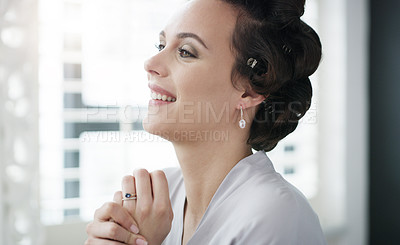 Buy stock photo Cropped shot of a beautiful young woman getting ready on her wedding day