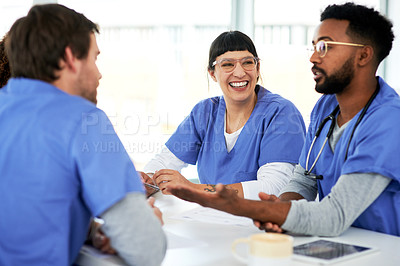 Buy stock photo Shot of a team of young doctors having a meeting in a hospital