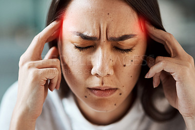 Buy stock photo Shot of a young woman suffering with a headache highlighted in red