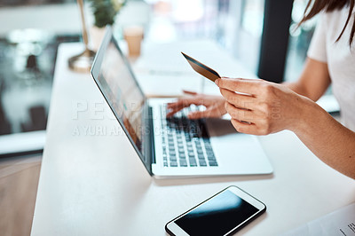 Buy stock photo Closeup shot of an unrecognisable businesswoman using a laptop and credit card in an office
