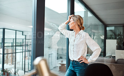 Buy stock photo Shot of a mature businesswoman looking stressed out in an office