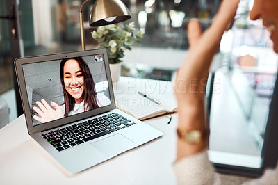 Buy stock photo Shot of a young woman waving while appearing on a laptop screen during a video call