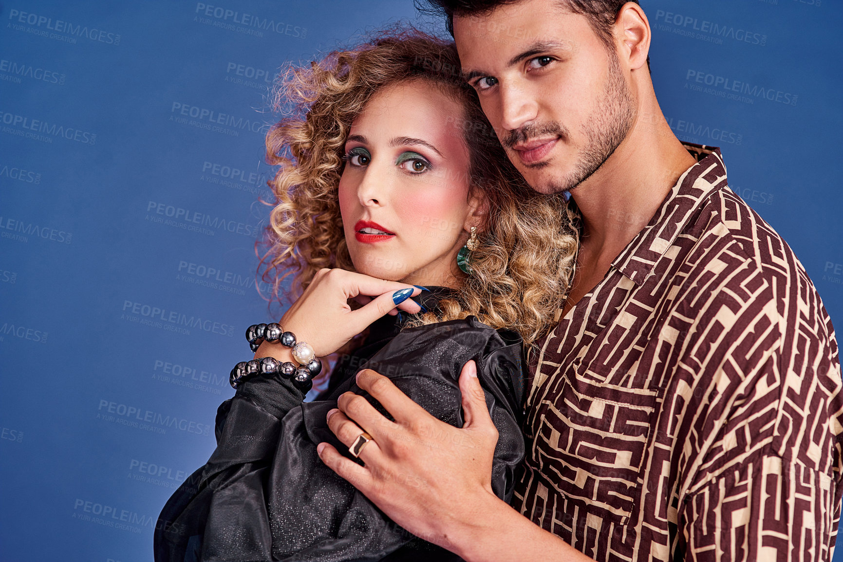 Buy stock photo Studio shot of a young couple styled in 80s clothing