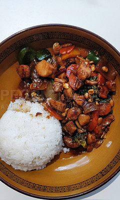 Buy stock photo Shot of a delicious Asian meal prepared with meat, broccoli, carrots and nuts served wth rice at a restaurant