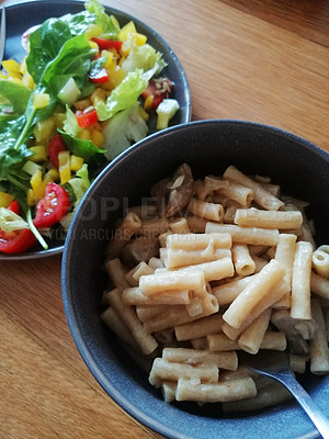 Buy stock photo Shot of a bowl of vegan macaroni and cheese served with a freshly made salad
