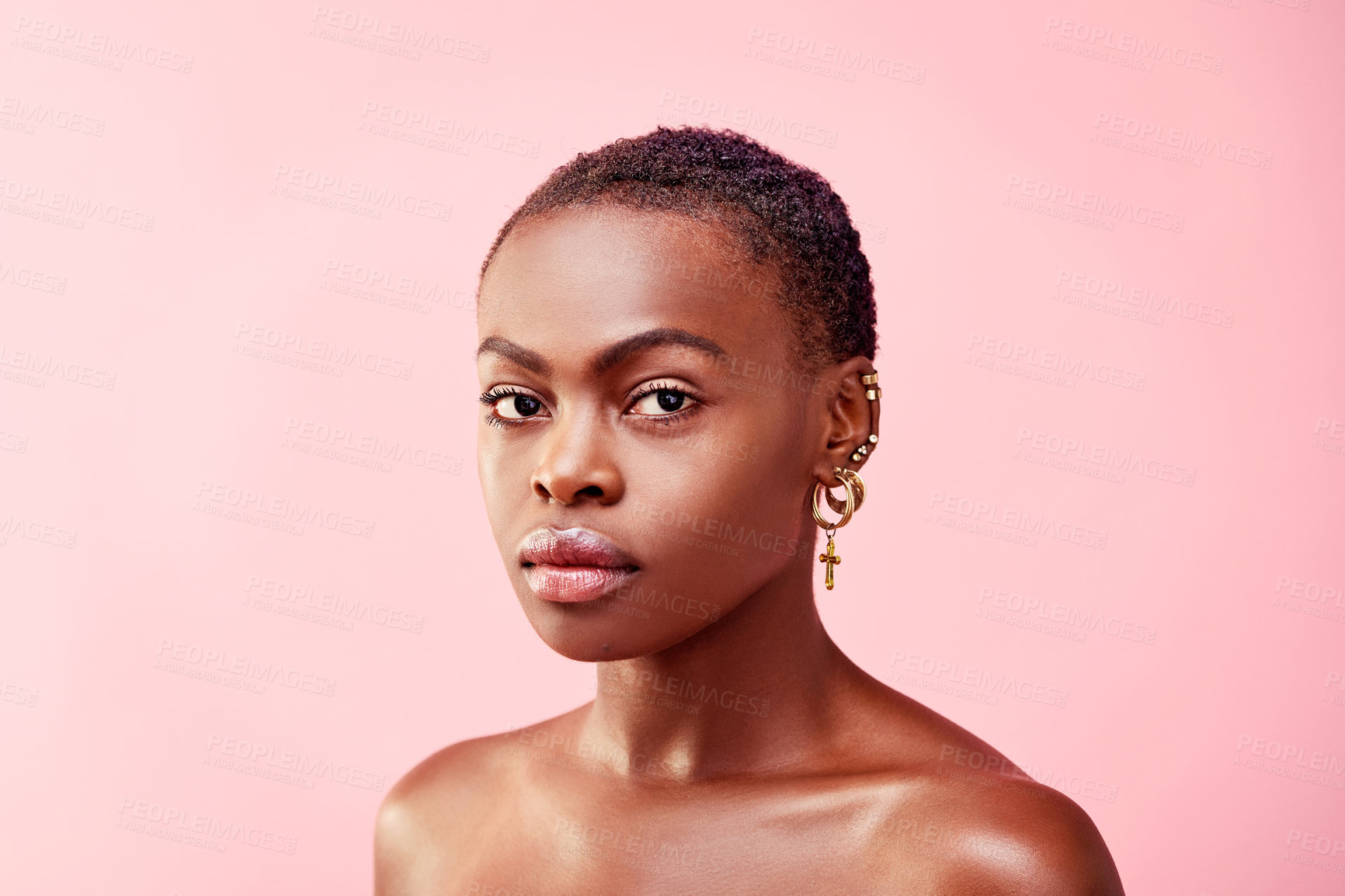 Buy stock photo Studio portrait of a beautiful young woman posing against a pink background