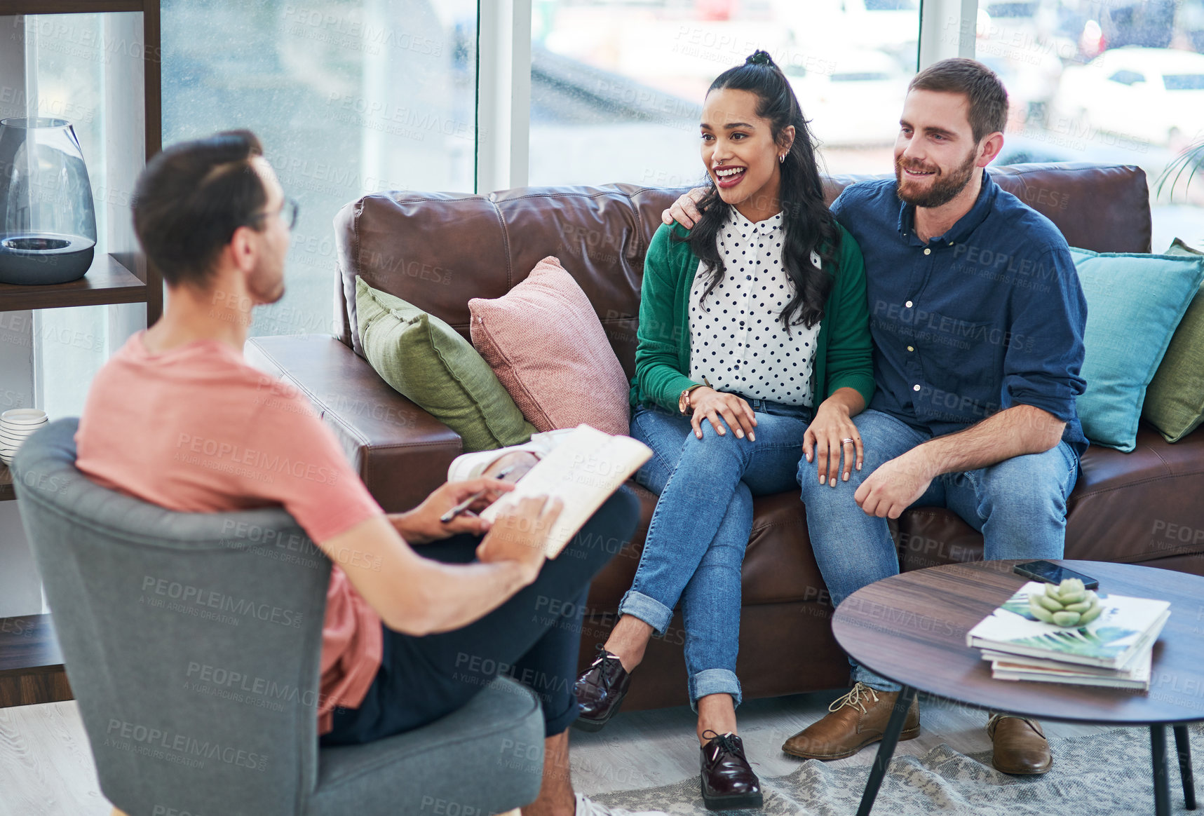 Buy stock photo Shot of a young couple having a consultation with a specialist