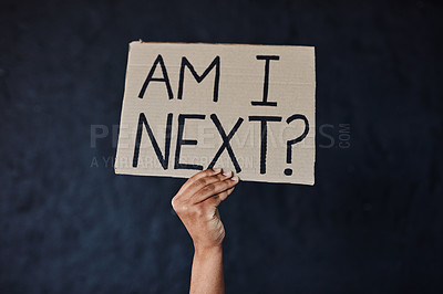 Buy stock photo Studio shot of an unrecognisable woman protesting against gender based violence against a dark background