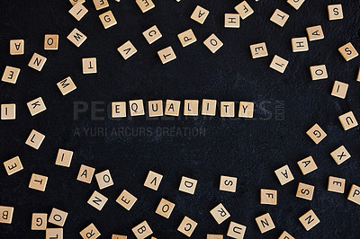 """Buy stock photo Studio shot of a wooden tiles with letters spelling out """"Equality"""" against a black background"""