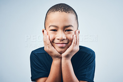 Buy stock photo Studio shot of a cute little boy posing against a grey background