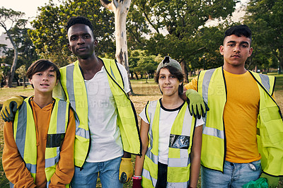 Buy stock photo Cropped portrait of a group of young volunteers doing community service in their local park