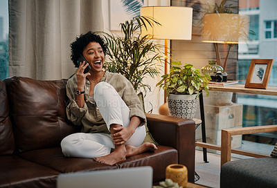 Buy stock photo Shot of a young woman talking on her cellphone while sitting at home
