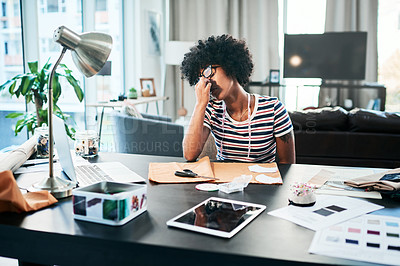 Buy stock photo Cropped shot of a young designer looking stressed while working from home