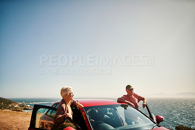 Buy stock photo Shot of a senior couple stopping to admire the view during a road trip along the coast