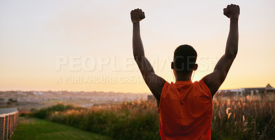 Buy stock photo Rearview shot of a sporty young man cheering while exercising outdoors