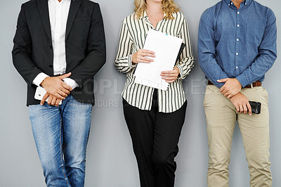 Buy stock photo Cropped studio shot of a group of businesspeople waiting in line against a grey background