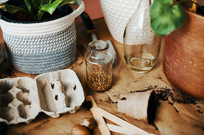 Buy stock photo Shot of various gardening items on a table at home