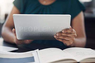 Buy stock photo Closeup shot of an unrecognisable businesswoman using a digital tablet in an office