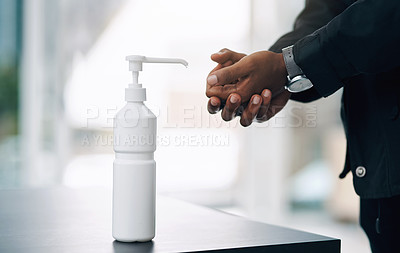 Buy stock photo Shot of an unrecognisable man disinfecting his hands with hand sanitiser