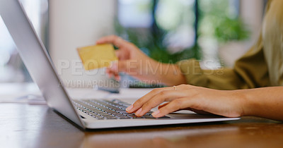 Buy stock photo Closeup shot of an unrecognisable woman using a laptop and credit card at home