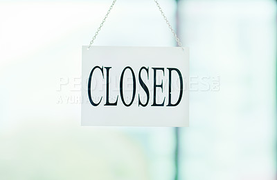 Buy stock photo Shot of a closed sign on the window of a store