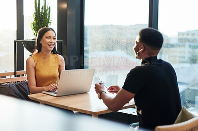 Buy stock photo Shot of a young businessman and businesswoman working together in a modern office