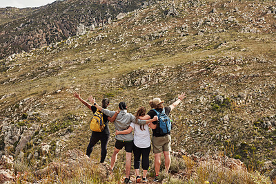 Buy stock photo Rearview shot of a group of young friends celebrating while out hiking in nature