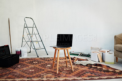 Buy stock photo Shot of a laptop on a stool in an empty home that's being renovated