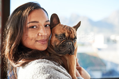 Buy stock photo Portrait of a young woman relaxing with her dog at home