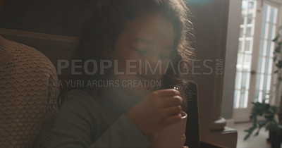 Buy stock photo Cropped shot of a little girl enjoying a hot beverage at home