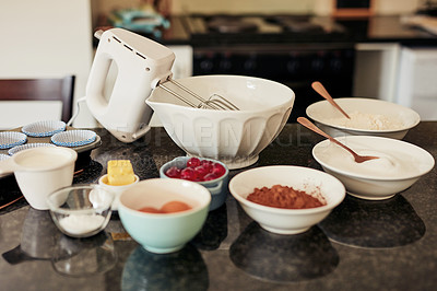 Buy stock photo Shot of various baking items on a kitchen counter at home