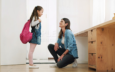 Buy stock photo Shot of a woman talking to her young daughter before she leaves home